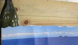 紐を解くと北アルプス立山連峰が!